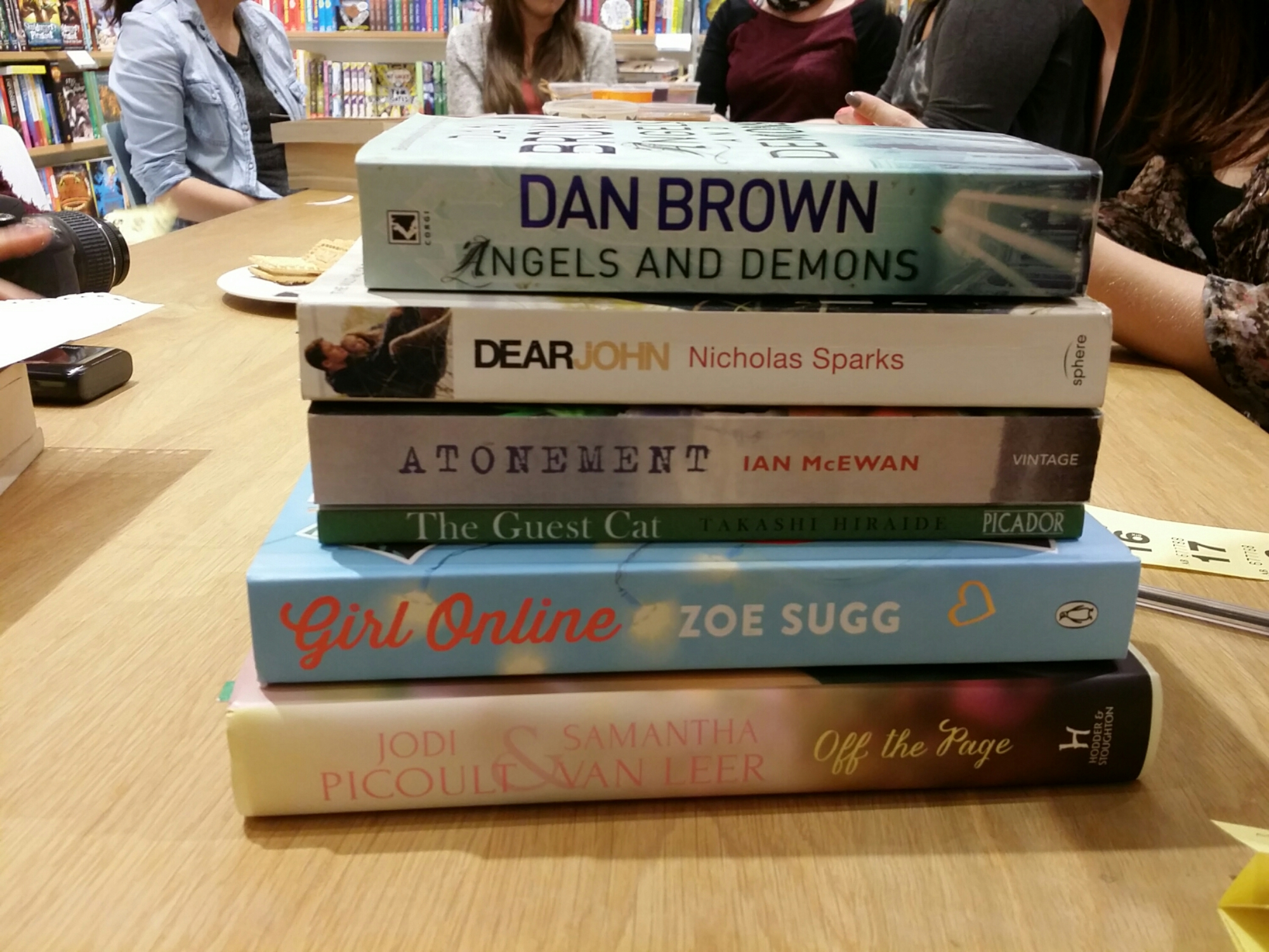 stack of books dan brown nicholas sparks ian mcewan zoe sugg